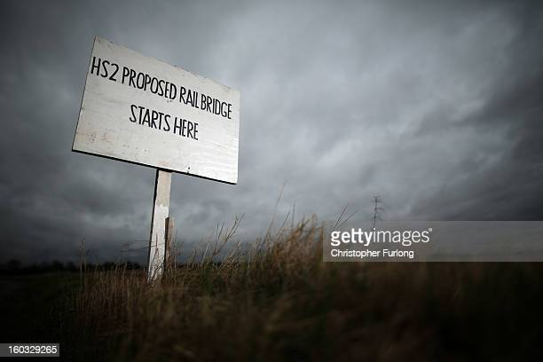 A sign erected by protesters marks the spot where a new rail bridge is proposed to be built across the countryside for the new HS2 high speed train...