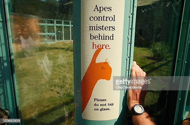 A sign explains that zoo visitors can be sprayed with a mist of water when the zoo's orangutans press a button outside the Think Tank exhibit at the...