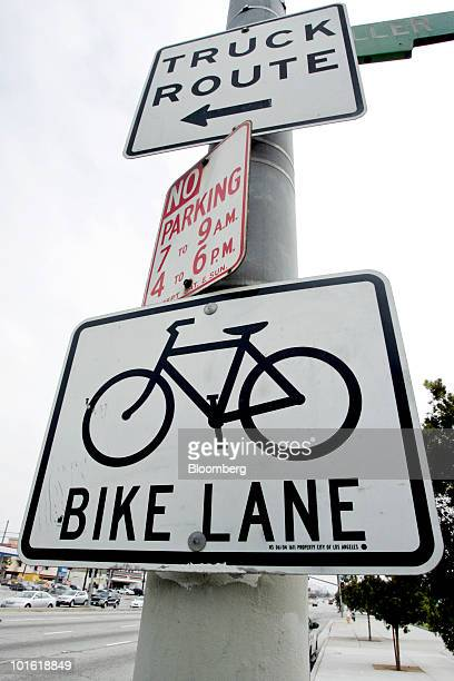 A sign for a bike lane is posted along Venice Boulevard in Los Angeles California US on Tuesday June 1 2010 The city of Los Angeles plans to spend...