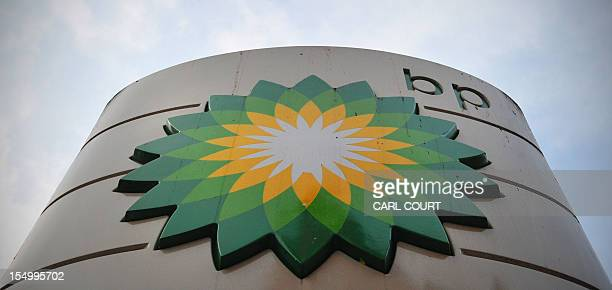A sign for a BP filling station is pictured in central London on October 30 2012 BP posted earnings far stronger than expected and hiked its dividend...