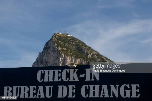 A sign for a Bureau De Change shop is seen in front of the Gibraltar Rock on April 3 2017 in Gibraltar Tensions have risen over Brexit negotiations...