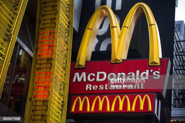 A sign for a McDonald's restaurant is seen in Times Square on June 9 2014 in New York City McDonald's domestic sales fell slightly in May marking one...