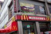 A sign for a McDonald's restaurant is seen on June 9 2014 in New York City McDonald's domestic sales fell slightly in May marking one of the longest...