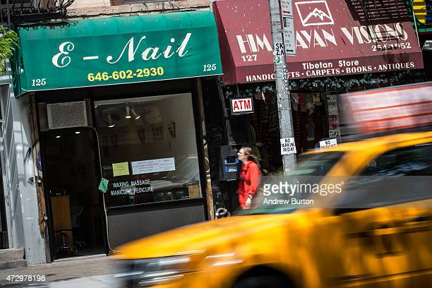 A sign for a nail salon is seen on May 11 2015 in the East Village neighborhood of New York City New York Governor Andrew Cuomo announced emergency...