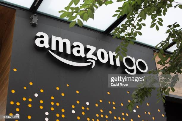 A sign for Amazon Go is seen outside the grocery store's location on June 16 2017 in Seattle Washington Amazon announced that it will buy Whole Foods...