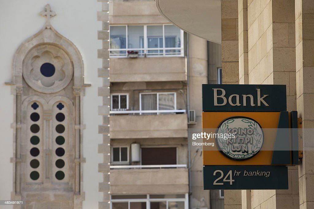 A sign for an automated teller machine (ATM) hangs outside a Bank of Cyprus Plc bank branch in Limassol, Cyprus, on Tuesday, April 8, 2014. Cyprus wants to shield financial flows with Russia, where it's the biggest foreign investor, as the U.S. and the European Union ratchet up sanctions in response to President Vladimir Putin's annexing Crimea from Ukraine. Photographer: Andrew Caballero-Reynolds/Bloomberg via Getty Images