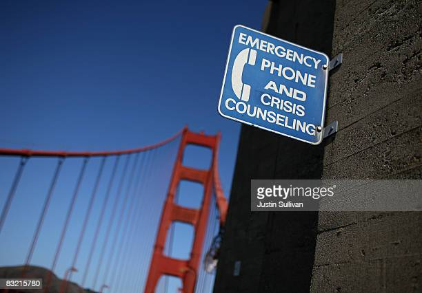 A sign for an emergency phone is seen on the span of the Golden Gate Bridge October 10 2008 in San Francisco California The Golden Gate Bridge...