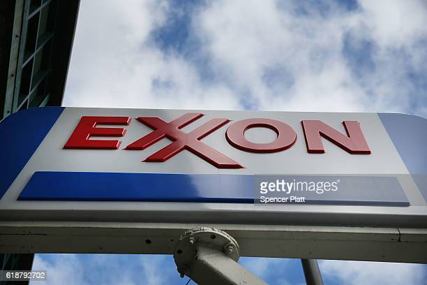 A sign for an Exxon gas station stands in a Brooklyn neighborhood on October 28 2016 in New York City As lower gas prices continue to do damage to...