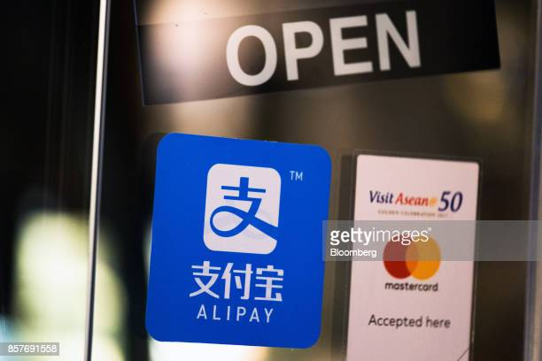 A sign for Ant Financial Services Group's Alipay an affiliate of Alibaba Group Holding Ltd is displayed at a store in Bangkok Thailand on Thursday...