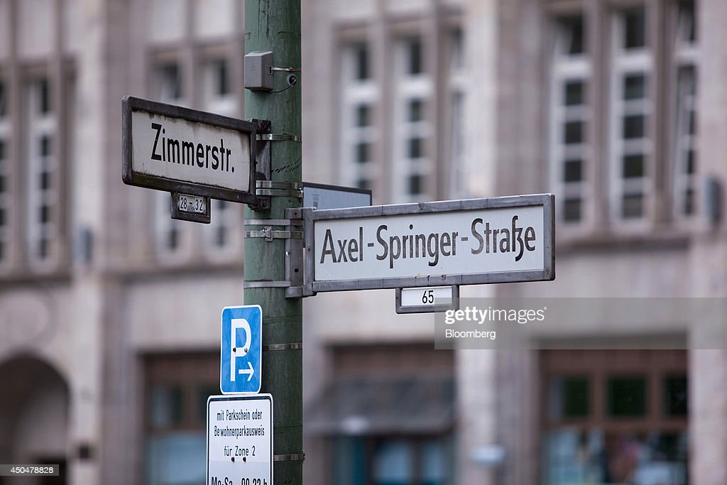 A sign for Axel Springer Street stands near the offices of newspaper publisher Axel Springer SE, in Berlin, Germany, on Wednesday, June 11, 2014. Axel Springer, Europe's biggest newspaper publisher, is working with JPMorgan Chase & Co. and Citigroup Inc. on an initial public offering of its digital-classifieds business, people familiar with the matter said. Photographer: Krisztian Bocsi/Bloomberg via Getty Images