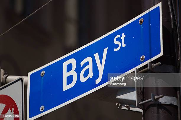 A sign for Bay Street is displayed in the financial district of Toronto Ontario Canada on Wednesday July 18 2012 The Bank of Canada said consumers...
