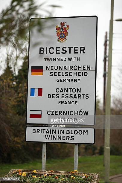 A sign for Biscester is pictured on a road leading into Bicester on December 2 2014 in Bicester England Up to 13000 new homes are due to be built on...
