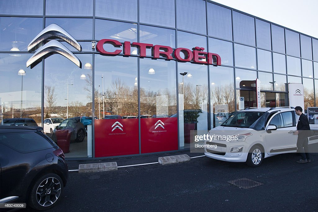 Inside a psa peugeot citroen showroom as europe december for Via motors truck price