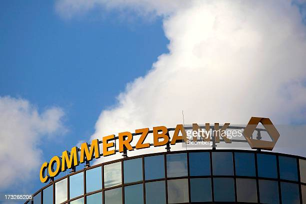 A sign for Commerzbank AG Germany's secondbiggest bank is seen on top of a building in Berlin Germany on Wednesday July 10 2013 The European Union's...
