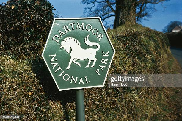 A sign for Dartmoor National Park in Devon UK April 1963