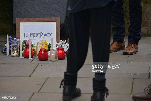 A sign for democracy at a mock burial site during a demonstration in solidarity with the people of Wallonia against 'CETA' on October 27 2016 in...