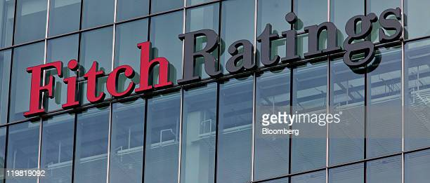 A sign for financial ratings agency Fitch Ratings sits on a building at the Canary Wharf business district in London UK on Monday July 25 2011...