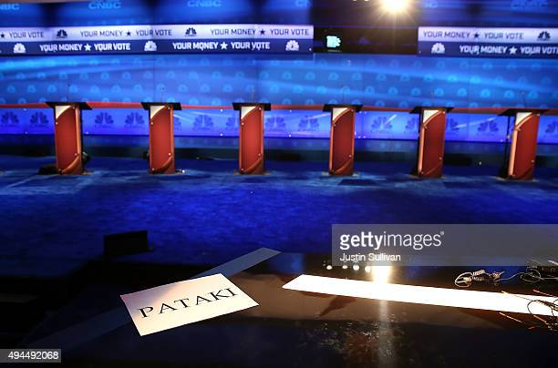 A sign for former New York Governor George Pataki sits on a desk as the stage is prepared for the CNBC Republican presidential debate at the...