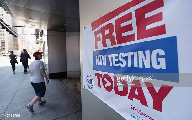 A sign for free HIV testing is seen outside a Walgreens pharmacy in Times Square on June 27 2012 in New York City June 27 is National HIV Testing Day...