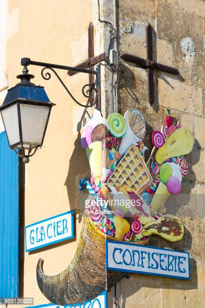 Sign for ice cream and confiserie confectionery shop in Coulon in the Marais Poitrevin region France