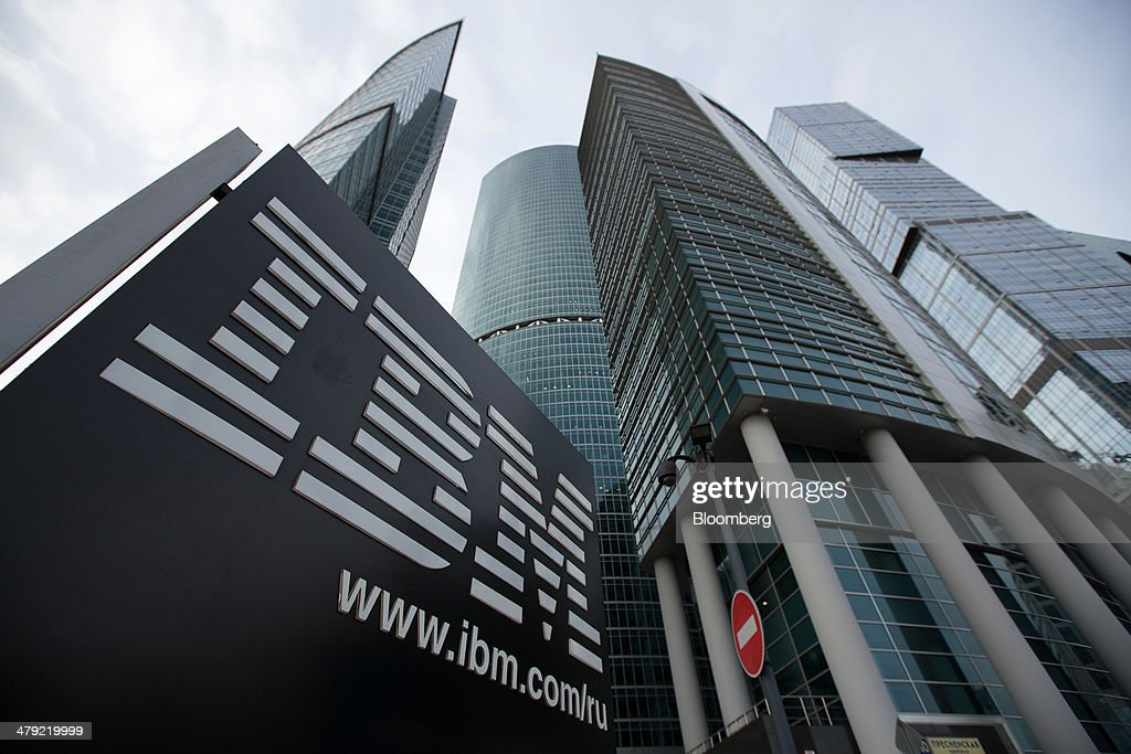A sign for International Business Machines Corp. (IBM) stands outside offices at the Moscow International Business Center, also known as 'Moscow City,' in Moscow, Russia, on Sunday, March 16, 2014. The U.S. and the European Union warned Russia not to annex Crimea after a referendum in the southern Ukrainian region, setting the stage for sanctions on Russia in the worst diplomatic standoff since the Cold War. Photographer: Andrey Rudakov/Bloomberg via Getty Images