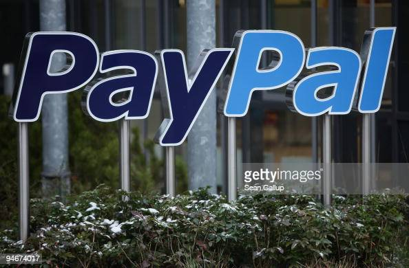A sign for Internet payment transaction portal PayPal stands outside the eBay Germany headquarters on December 17 2009 in Kleinmachnow Germany The...