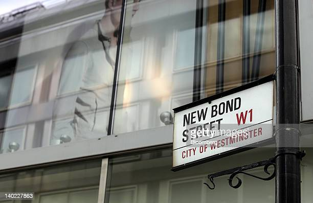 A sign for New Bond Street is seen hanging from a post in London UK on Wednesday Feb 29 2012 Bank of England Deputy Governor Charles Bean yesterday...
