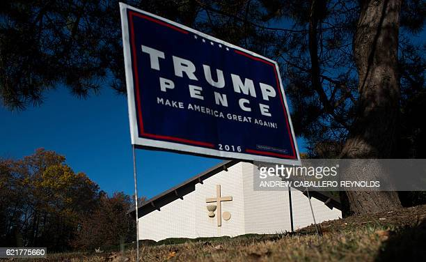 A sign for Republican presidential nominee Donald Trump is seen outside a polling place at a church in Fairfax Virginia during the US presidential...
