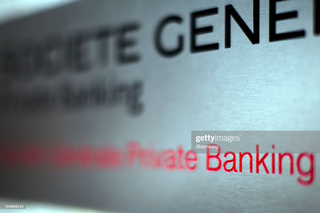 A sign for Societe Generale SA's Private Banking division is seen outside an office building in Geneva, Switzerland, on Monday, Oct. 29, 2012. Geneva's banks employed 502 fewer people at the end of June compared with a year earlier as foreign wealth managers cut jobs and shifted employees to other locations, a survey by the city's financial lobby group shows. Photographer: Valentin Flauraud/Bloomberg via Getty Images