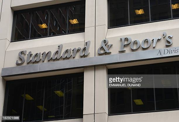 A sign for Standard Poor's rating agency stands in front of the company headquarters in New York September 18 2012 / AFP / EMMANUEL DUNAND