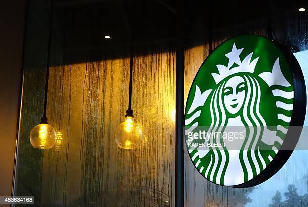 A sign for Starbucks is seen August 11 2015 in Washington DC AFP PHOTO / KAREN BLEIER