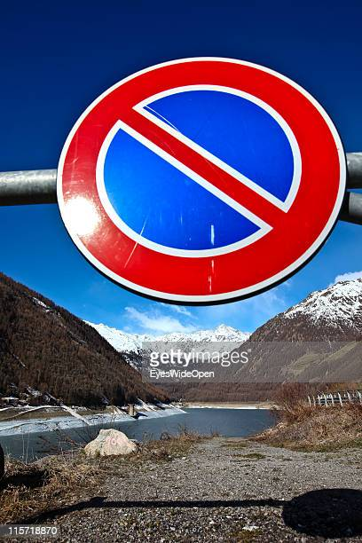Sign for stopping restriction at the Vernagter dammed Lake on June 08 2011 in Bolzano Italy Val Senales is a glacier region that is famous for Oetzi...