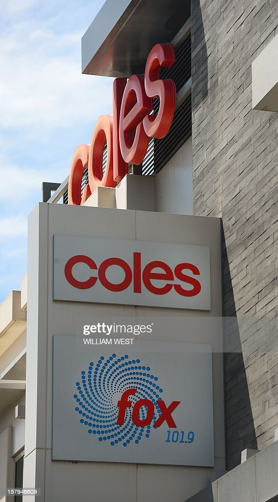 A sign for supermarket giant Coles (top) is displayed above a sign for a Southern Cross Austereo radio station (bottom) in Melbourne on December 8, 2012. Coles announced they would withdraw advertising from Southern Cross Austereo after two Australian radio presenters duped a woman working at a London hospital which treated Prince William's pregnant wife Catherine and who was later found dead. Media reports said Jacintha Saldanha, who had worked at the King Edward VII hospital in London for four years, had committed suicide while police said they were treating the death as unexplained. Saldanha had accepted the hoax call from two radio presenters from Sydney's 2Day FM pretending to be Queen Elizabeth II and William's father Prince Charles, before passing it onto a colleague who divulged details of Kate's condition. AFP PHOTO/William WEST