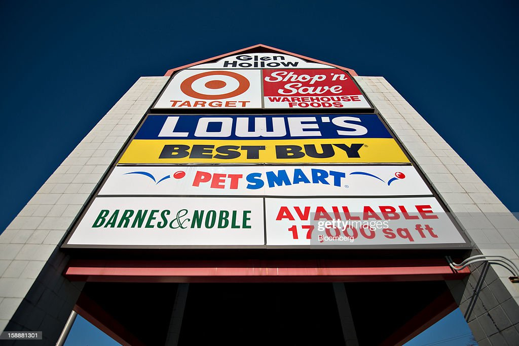 A sign for Target Corp., Lowe's Cos., Best Buy Co., PetSmart Inc., and Barnes & Noble Inc. stores stands outside of a shopping mall in Peoria, Illinois, U.S., on Wednesday, January 2, 2013. The International Council of Shopping Centers is scheduled to release U.S. chain store sales data on Jan. 3. Photographer: Daniel Acker/Bloomberg via Getty Images