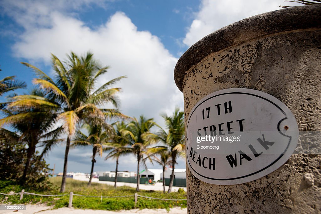 A sign for the 17th Street Boardwalk welcomes people in Miami Beach, Florida, U.S., on Wednesday, Feb. 20, 2013. U.S. exports in the travel and tourism sector reached $168.1 billion in 2012, up 10.1 percent from the year-ago level of $152.7 billion, according to data released Feb. 22 by the Commerce Department's International Trade Administration. Photographer: Ty Wright/Bloomberg via Getty Images