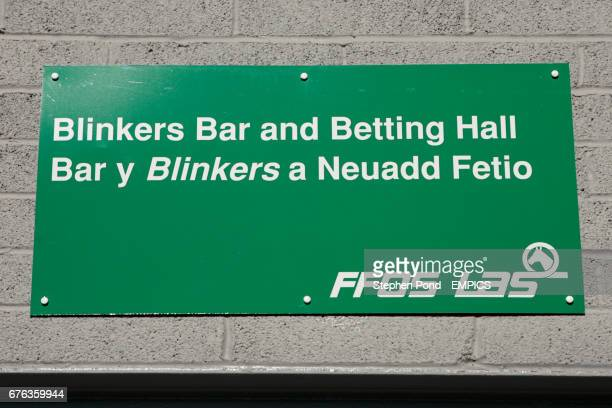 A sign for the Blinkers bar and betting hall at Ffos Las