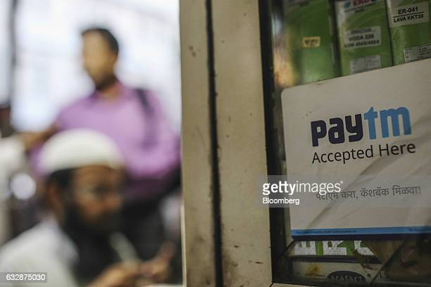 A sign for the PayTM online payment method operated by One97 Communications Ltd is displayed at a mobile repair shop in Mumbai India on Friday Jan 27...
