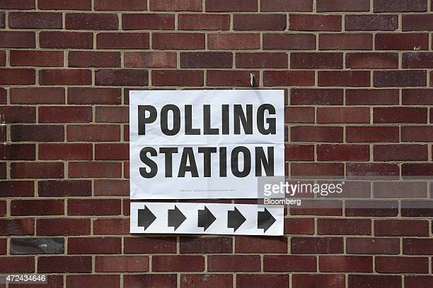 A sign for the polling station at St Giles Cripplegate Church in the City of London is posted on a brick wall during the 2015 general election in...