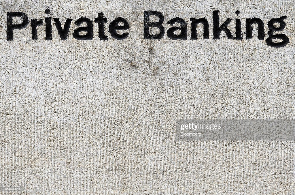 A sign for the Private Banking division of Societe Generale SA is seen displayed outside their offices in Geneva, Switzerland, on Sunday, Oct. 28, 2012. Geneva's banks employed 502 fewer people at the end of June compared with a year earlier as foreign wealth managers cut jobs and shifted employees to other locations, a survey by the city's financial lobby group shows. Photographer: Valentin Flauraud/Bloomberg via Getty Images