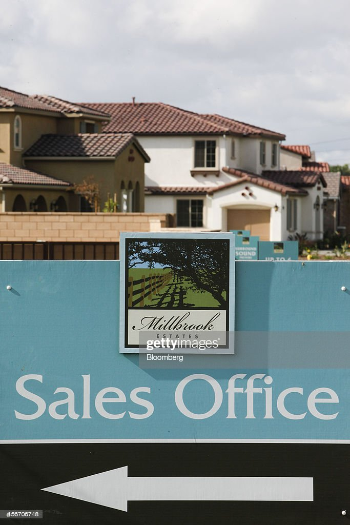 A sign for the sales office of ETCO Homes Millbrook Estates development is displayed outside of a model home in Rancho Cucamonga, California, U.S., on Sunday, Nov. 18, 2012. The U.S. Census Bureau is scheduled to release housing starts figures on Nov. 20. Photographer: Patrick T. Fallon/Bloomberg via Getty Images