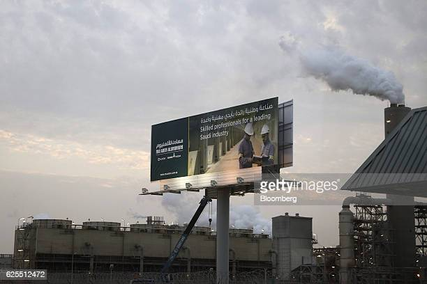 A sign for the Saudi Arabian Mining Co and its partners sits above the Ras Al Khair Industrial City complex in Ras Al Khair Saudi Arabia on Wednesday...