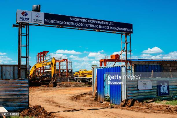 A sign for the Sinohydro Corp Ltd sits above the entrance road to the construction site for a hydro pumping station which will supply water from the...