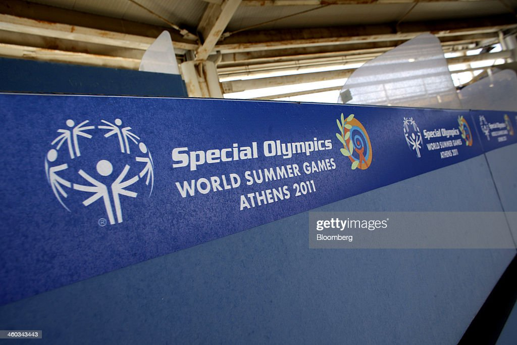 A sign for the Special Olympics World Summer Games 2011 sits on an abandoned press kiosk at the former Athens International Airport in the Hellenikon district of Athens, Greece, on Friday, Dec. 3, 2014. Hellenikon is the largest of Greece's land development projects, three times the size of the Principality of Monaco. Photographer: Kostas Tsironis/Bloomberg via Getty Images