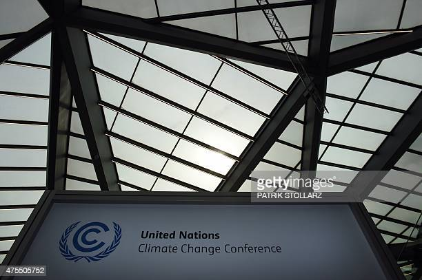 A sign for the United Nations Framework Convention on Climate Change is seen during the opening ceremony in Bonn western Germany on June 1 2015 The...