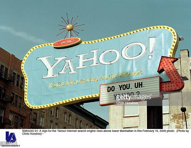 A sign for the Yahoo Internet search engine rises above lower Manhattan in this February 10 2000 photo