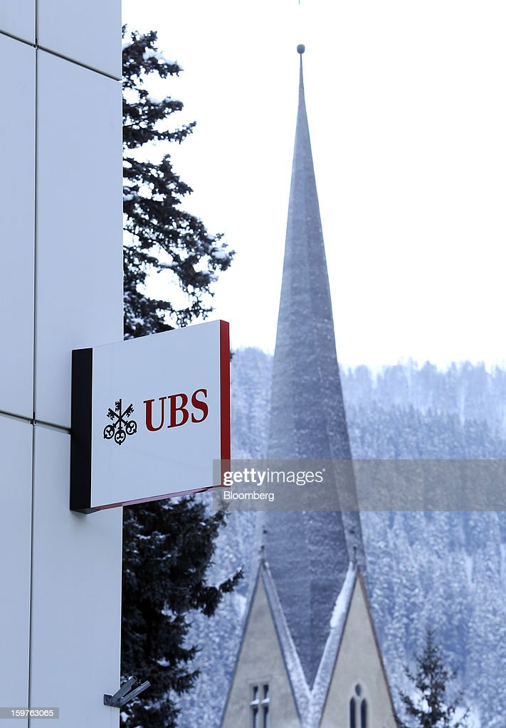 A sign for UBS AG is seen displayed outside a bank branch in the town of Davos, Switzerland, on Thursday, Jan. 17, 2013. Next week the business elite gather in the Swiss Alps for the 43rd annual meeting of the World Economic Forum in Davos, the five day event runs from Jan. 23-27. Photographer: Chris Ratcliffe/Bloomberg via Getty Images
