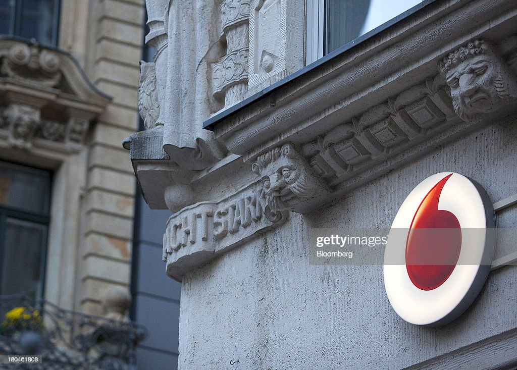 A sign for Vodafone is seen on the outside of a store operated by Vodafone Group Plc in Leipzig, Germany, on Thursday, Sept. 12, 2013. Vodafone Group Plc's 7.7 billion-euro ($10.2 billion) bid for Kabel Deutschland Holding AG cleared a major hurdle by winning the backing of at least 75 percent of the German company's shareholders. Photographer: Krisztian Bocsi/Bloomberg via Getty Images