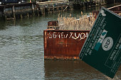 A sign from the Department of Environmental Protection hangs near the polluted Gowanus Canal on June 2 2009 in the Brooklyn borough of New York City...