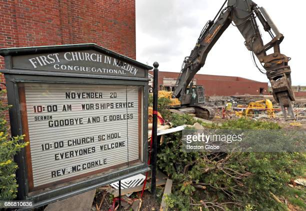 A sign from the First Congregational Church in Malden MA is pictured on May 10 2017 Crews have begun demolition on the old police station and City...
