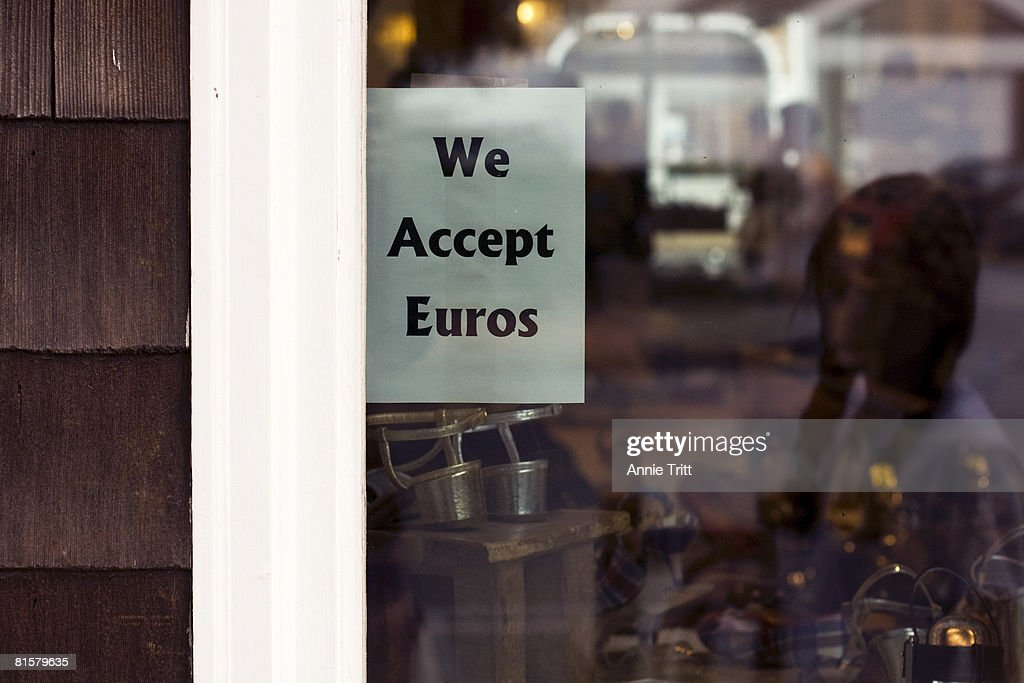 A sign hanging in the window of Shoe In indicates that, like several Hampton retailers, they have begun accepting Euros as payment, catering to the large amounts of visiting Europeans and the weak dollar, June 15, 2008, East Hampton, in the Hamptons section of Long Island, New York. This is the first year they are doing so.